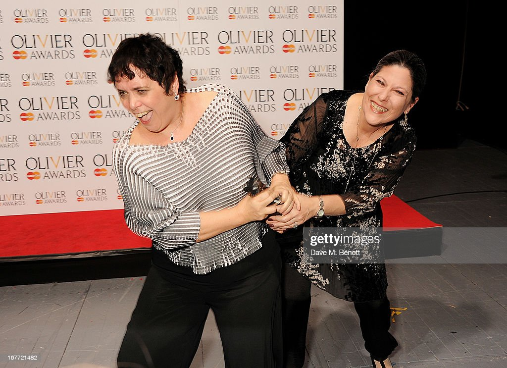 Nica Burns (L) and Kim Poster, winners of Best Revival for 'Long Day's Journey Into Night', pose in the press room at The Laurence Olivier Awards 2013 at The Royal Opera House on April 28, 2013 in London, England.