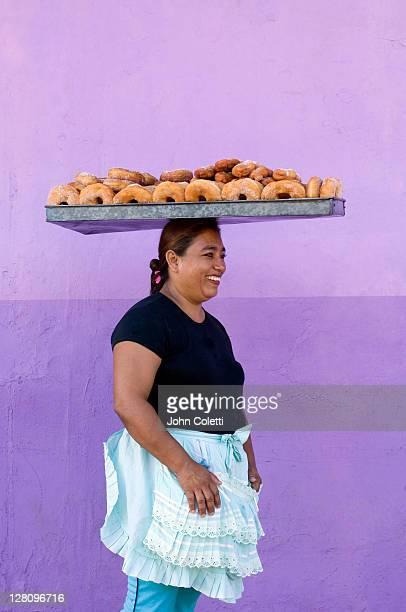 Nicaragua, Granada, Street vendor with donuts