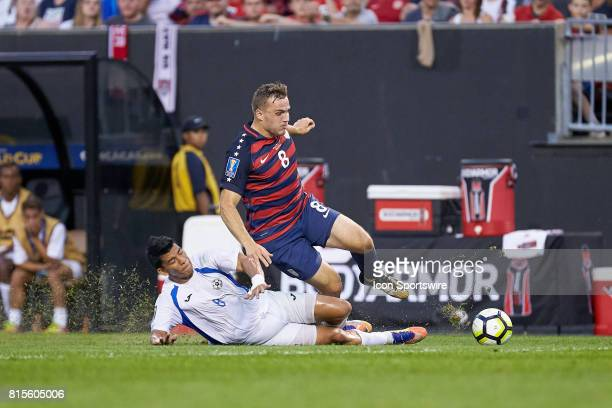 Nicaragua midfielder Marlon Lopez tackles United States forward Jordan Morris for a loose ball during a CONCACAF Gold Cup Group B match between the...