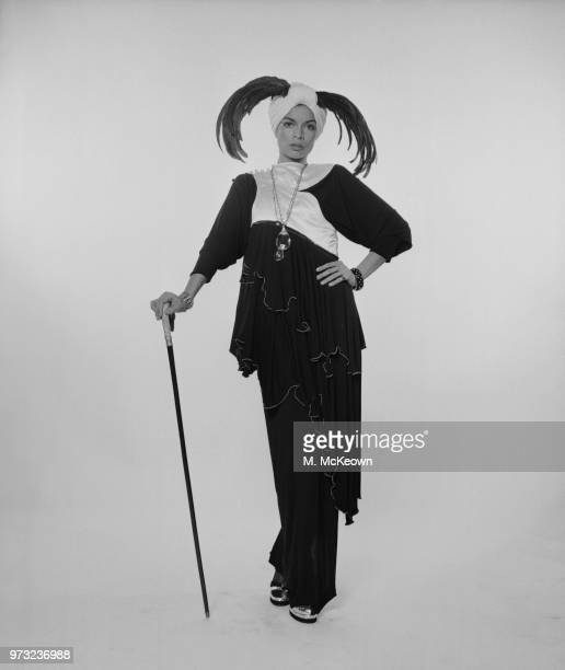 Nicaraguan actress, fashion model and activist Bianca Jagger wearing black evening dress and turban hat with feathers detail, UK, 19th December 1972.