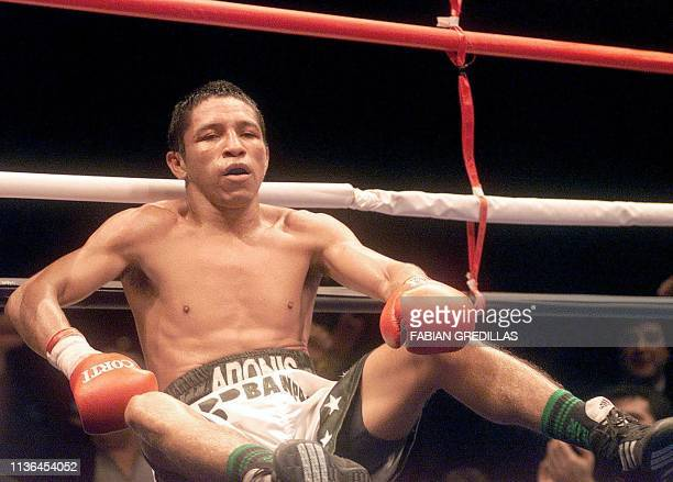 Nicaraguan Adonis Rivas listens to the knockout count after being defeated in the seventh round by Argentinian Omar Narvaez during the fight for the...