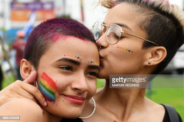 Nicaraguan antigovernment protesters including members of the Lesbian Gay Bisexual Transgender/Transsexual and Intersexed movement take part in an...