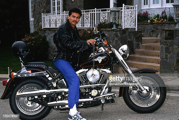 Nicaraguan boxer and politician Alexis Arguello poses for a portrait on a HarleyDavidson motorcycle in January 1994 in Los Angeles California