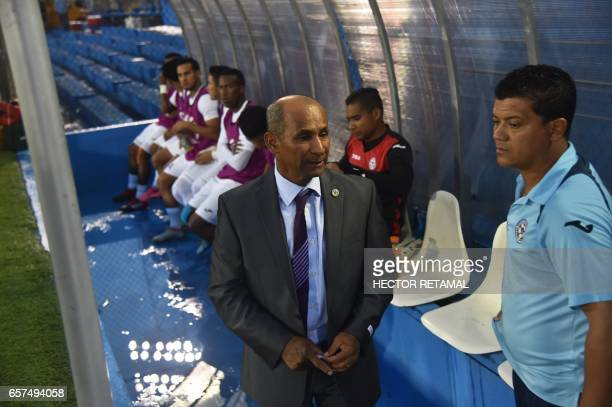Nicaraguan coach Henry Duarte speaks during the match against Haiti at the Sylvio Cator Stadium in PortauPrince on March 24 the first of two match to...