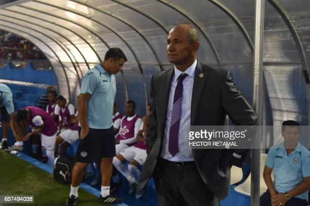 Nicaraguan coach Henry Duarte stands during the match against Haiti at the Sylvio Cator Stadium in PortauPrince on March 24 the first of two match to...