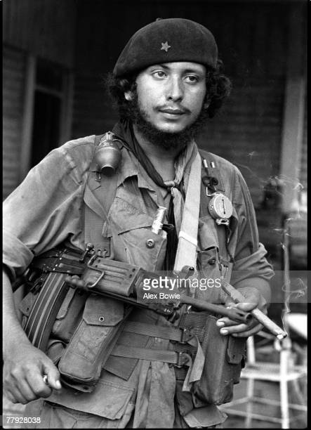 A Nicaraguan commander in the Sandinista National Liberation Front smokes a cigar 8th July 1979
