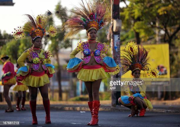 Nicaraguan dancers get ready before the start of the Joy for Life Carnival in Managua on April 27 2013 AFP PHOTO/Hector RETAMAL