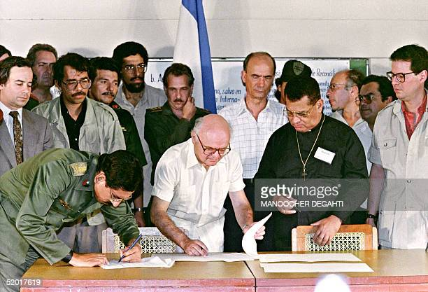 Nicaraguan Defence Minister Humberto Ortega signs a cease-fire agreement with contra rebels 23 March in Sapoa. L-to-R Nicaraguan President Daniel...