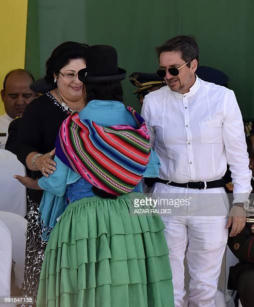 Nicaraguan Defense Minister Martha Ruiz Sevilla and Ecuador's Deputy Minister of Defense Felipe Vega greet an indigenous woman during the...