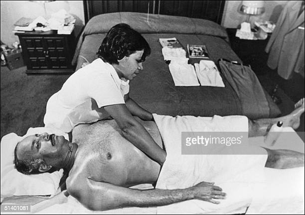 Nicaraguan dictator Anastasio Somoza is massaged by an unidentified masseuse in his Managua palace in 1978 a few months before being overthrown by...