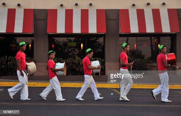 Nicaraguan drummers get ready before the start of the Joy for Life Carnival in Managua on April 27 2013 AFP PHOTO/Hector RETAMAL