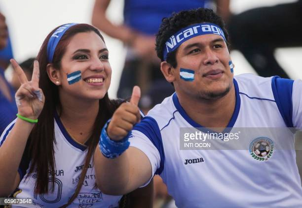 Nicaraguan fans pose during the second match of Nicaragua vs Haiti semifinal for the 2017 Gold Cup at the National Stadium in Managua on March 28...
