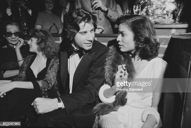 Nicaraguan former actress Bianca Jagger chats with American actor John Travolta at 'Saturday Night Fever' film premiere London UK 23rd March 1978