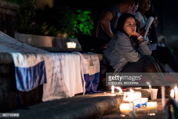 Nicaraguan inmigrants living in Costa Rica demonstrate in support of Nicaraguans protesting against government's pension reforms during a vigil at...