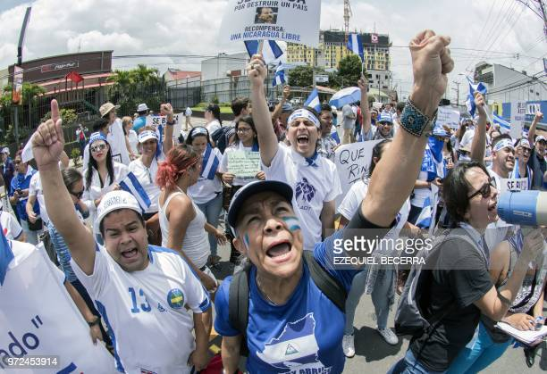 A Nicaraguan living in Costa Rica demonstrates with local protesters in San Jose on June 12 in solidarity with the students arrested and killed in...