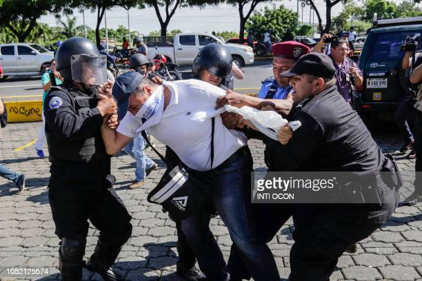 Nicaraguan man is arrested by riot police during a protest against the government of President Daniel Ortega in Managua on October 14 2018