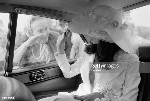Nicaraguan model actress and human rights advocate Bianca Perez Morena de Marcias waving from the wedding car after her marriage to British rock...
