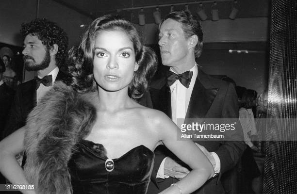 Nicaraguan model and actress Bianca Jagger and American fashion designer Halston attend the Glory of Russian Costume Exhibition, held in the...