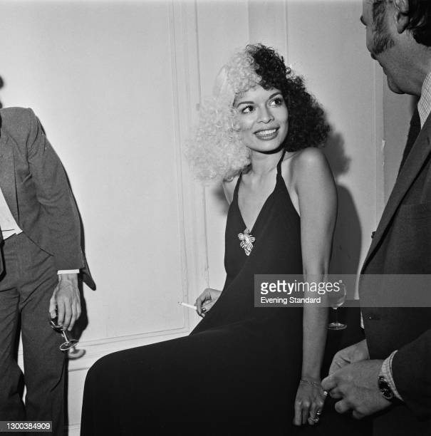 Nicaraguan model Bianca Jagger wearing a two-tone wig to the Oxfam Maytime Fair at the Grosvenor House Hotel in London, UK, 16th May 1972.