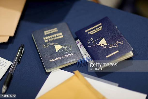 Nicaraguan passports are seen as people are helped apply for United States citizenship September 13 2014 in Miami Florida The clinic put on by the...