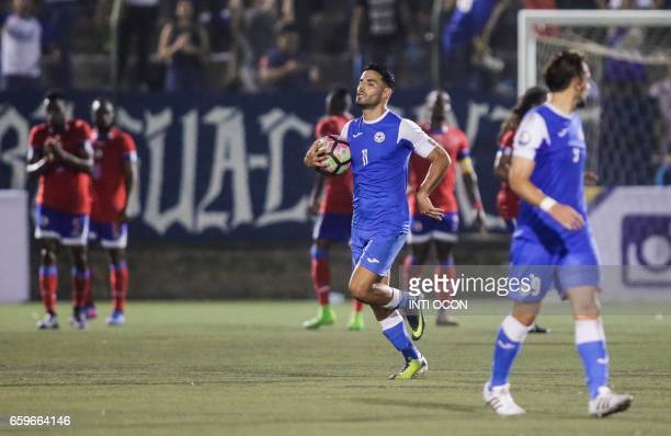 Nicaraguan player Juan Barrera celebrates after scoring against Haiti during a 2017 Gold Cup qualifier match at the National Stadium in Managua on...
