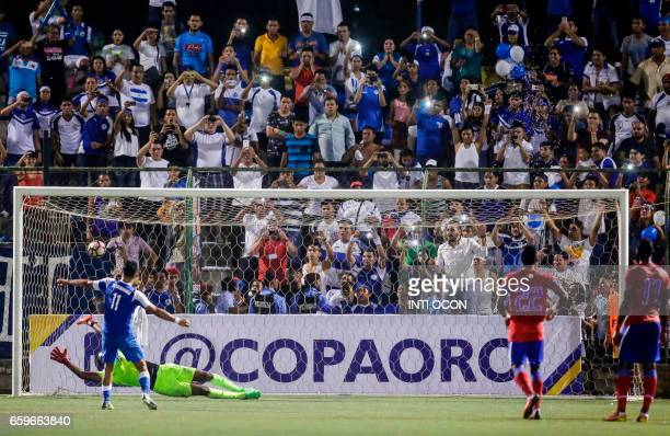 Nicaraguan player Juan Barrera scores against Haiti during a 2017 Gold Cup qualifier match at the National Stadium in Managua on March 28 2017 The...