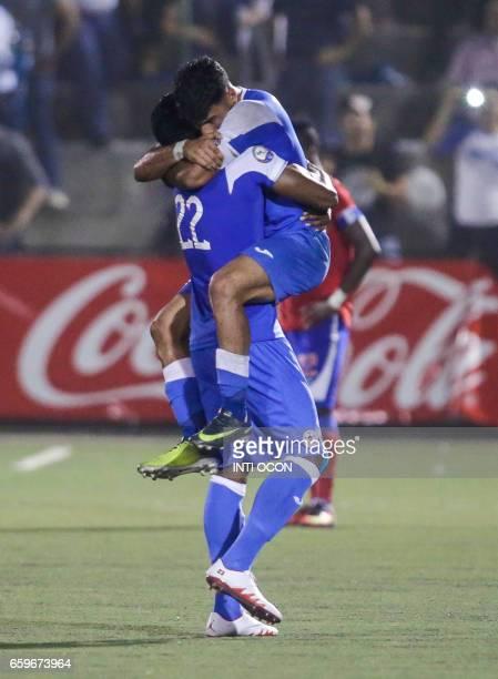 Nicaraguan players Cyrill Erriltong carries Juan Barrera celebrating Barrera´s second goal against Haiti during the second match of Nicaragua vs...