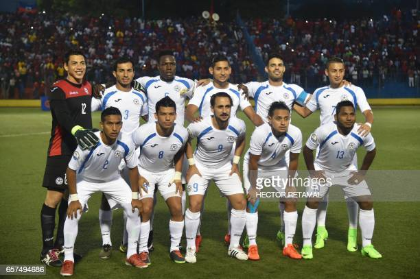 Nicaraguan players pose for a picture before the start of the match against Haiti at the Sylvio Cator Stadium in PortauPrince on March 24 the first...