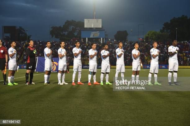 Nicaraguan players sing before the match against Haiti at the Sylvio Cator Stadium in PortauPrince on March 24 the first of two match to define the...