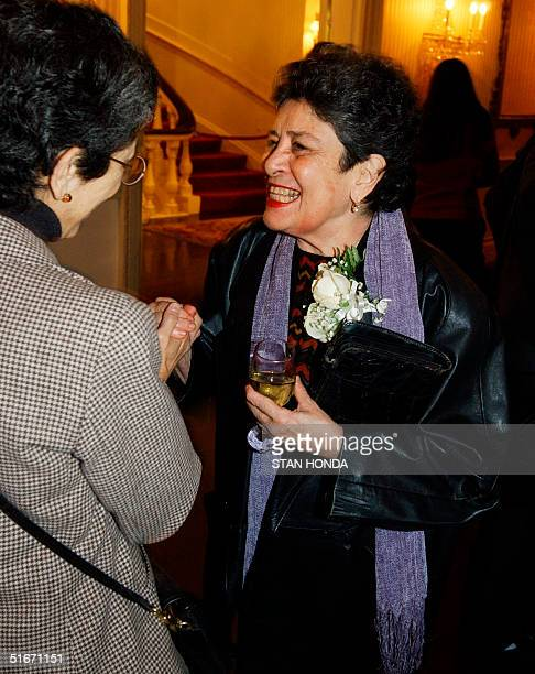 Nicaraguan poet Claribel Alegria greets a friend at The Americas Society 17 October 2002 at Hunter College in New York Alegria and fellow Nicaraguan...