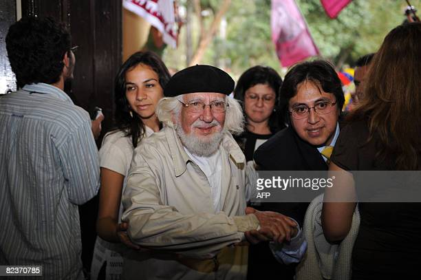 Nicaraguan poet Father Ernesto Cardenal arrives at a press conference to be held on August 15 2008 at Asuncion's railway station in the framework of...