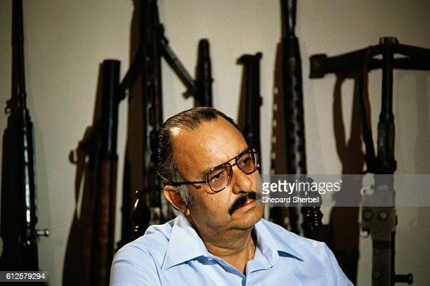 Nicaraguan president Anastasio Somoza Debayle sits in front of a row of weapons Anastasio Somoza Debayle son of former president Anastasio Somoza...