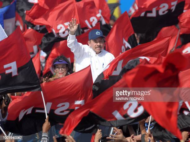Nicaraguan President Daniel Ortega and his wife Vice President Rosario Murillo wave to supporters during the commemoration of the 39th Anniversary of...