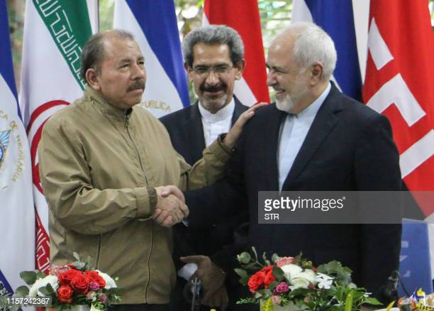 Nicaraguan President Daniel Ortega and Iran's Foreign Minister Mohammad Javad Zarif shake hands during a meeting in Managua on July 22 2019 Zarif...