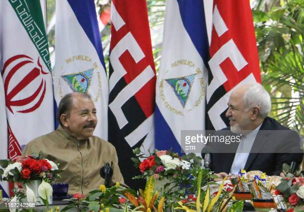 Nicaraguan President Daniel Ortega and Iran's Foreign Minister Mohammad Javad Zarif talk during a meeting in Managua on July 22 2019 Zarif arrived in...