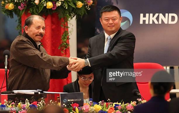 Nicaraguan President Daniel Ortega shake hands with Wang Jing president of of the Chinese company HK Nicaragua Development Gran Canal Interoceanico...
