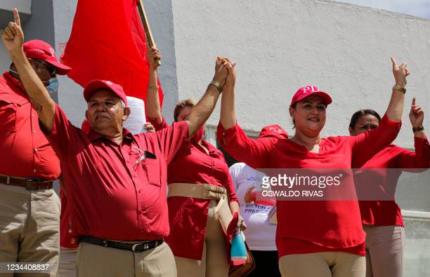 Nicaraguan presidential candidate for the Constitutionalist Liberal Party , Milton Arcia and his running mate Maria Dolores Moncada stand outside the...
