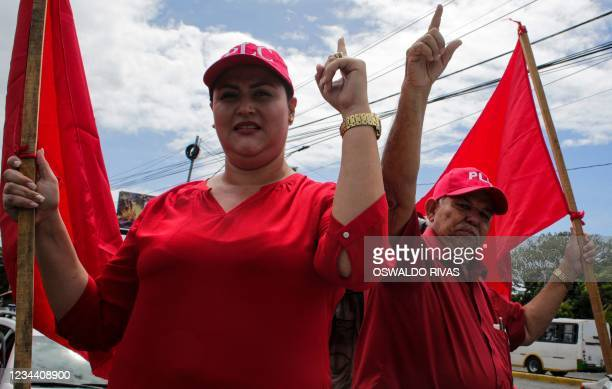 Nicaraguan presidential candidate for the Constitutionalist Liberal Party , Milton Arcia and his running mate Maria Dolores Moncada gesture outside...
