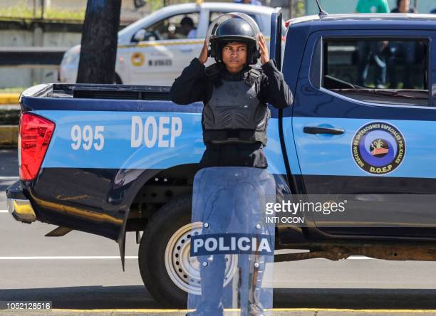Nicaraguan riot police is pictured during a protest against the government of President Daniel Ortega in Managua on October 14 2018