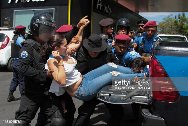 Nicaraguan riot police officers arrest a protester before a demonstration called by opposition groups to demand the government the release of those...