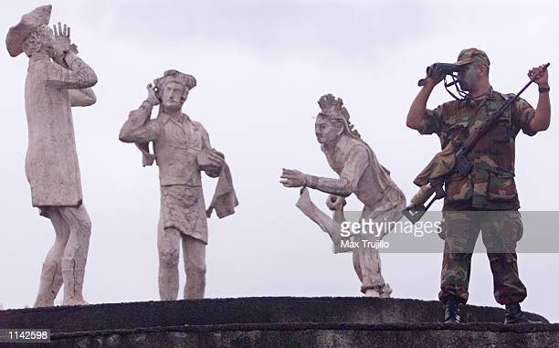 Nicaraguan soldier stands guard at a monument November 2 2001 in Managua Nicaragua Military and police presence has been increased in the Central...