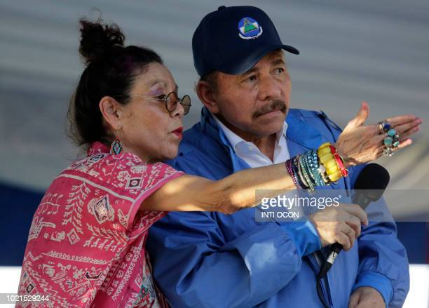 Nicaraguan Vice President Rosario Murillo gestures next to his husband Nicaraguan President Daniel Ortega, during a rally marking the 40th...