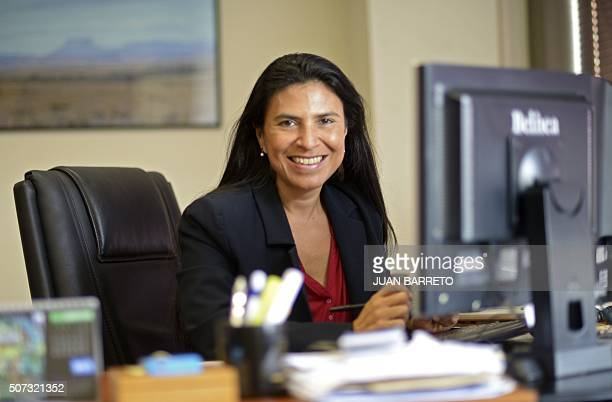 Nicaraguanborn Costa Rican Maria Isabel Sanchez director of the Venezuela and Caribbean AFP office poses at her desk in Caracas on January 28 2016...