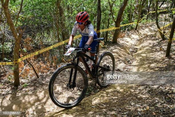Nicaragua's Maria Silva competes in the Women's Mountain Bike Cross Country finals event of the cyclying competition of the 2018 Central American and...