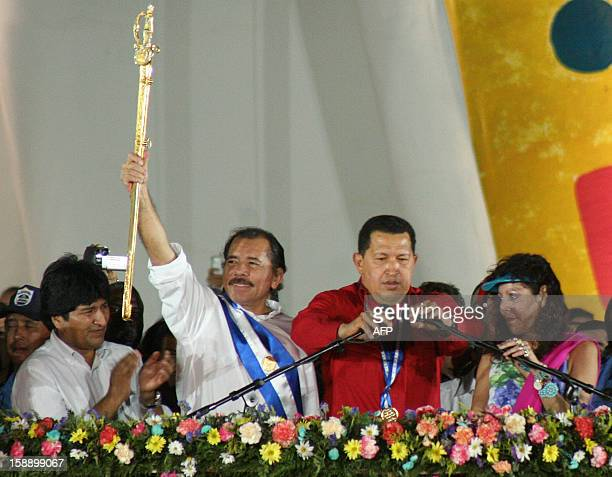 Nicaragua's new President Daniel Ortega brandishes a replica of the Bolivar Sword given by Venezuelan counterpart Hugo Chavez with Bolivian President...