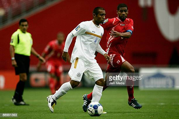 Nicaragua's player Armando Collado and Panama's player Alberto Blanco vies for the ball during the 2009 CONCACAF Gold Cup soccer match between...