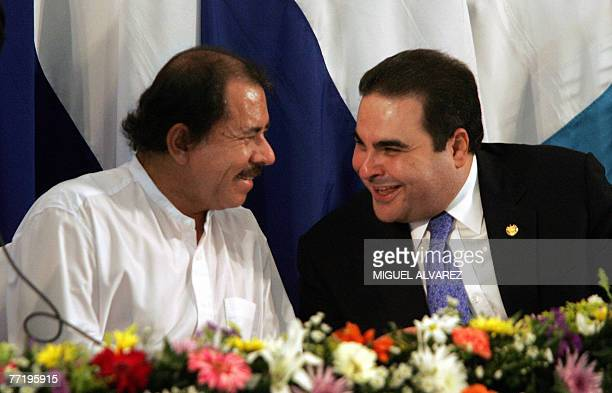 Nicaragua's president Daniel Ortega and Salvador's president Antonio Saca joke before the signing of an agreement to establish the Gulf of Fonseca as...