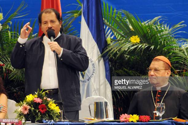 Nicaragua's President Daniel Ortega delivers a speech beside Cardinal Miguel Obando y Bravo president of the National Commission for Verification...