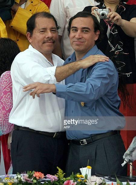 Nicaragua's President Daniel Ortega embraces Gonzalo Meza Allende, grandson of the former Chilean President Salvador Allende after he received...