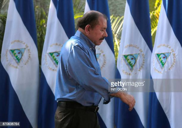 Nicaragua's President Daniel Ortega walks after giving a speech during the municipal elections in Managua on November 5 2017 Nicaraguans vote to...